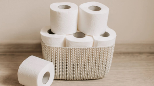 Toilets rolls stacked in basket