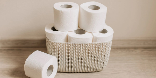 stack of toilet rolls in a basket